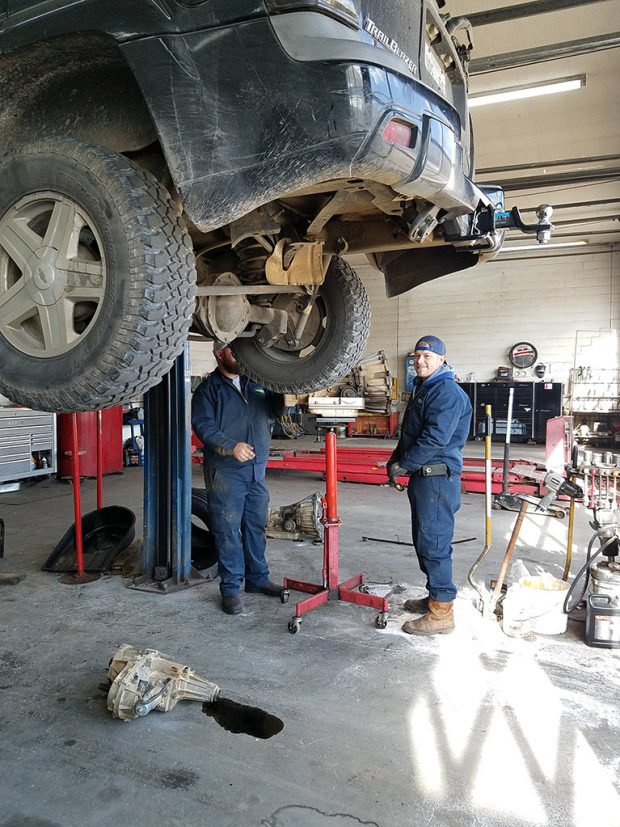 working on a car at the service center